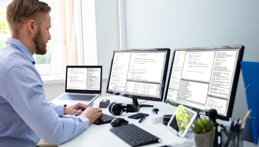 Man working from home with two monitors