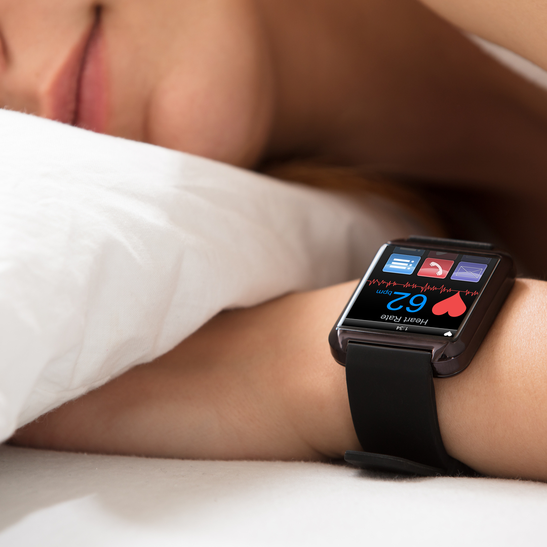 Smartwatch Showing Heartbeat Rate On Sleeping Woman's Hand