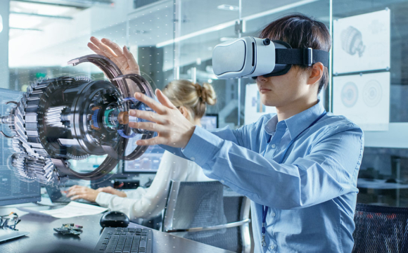Engineer wearing Virtual Reality Headset Works with 3D Model Hologram Visualization