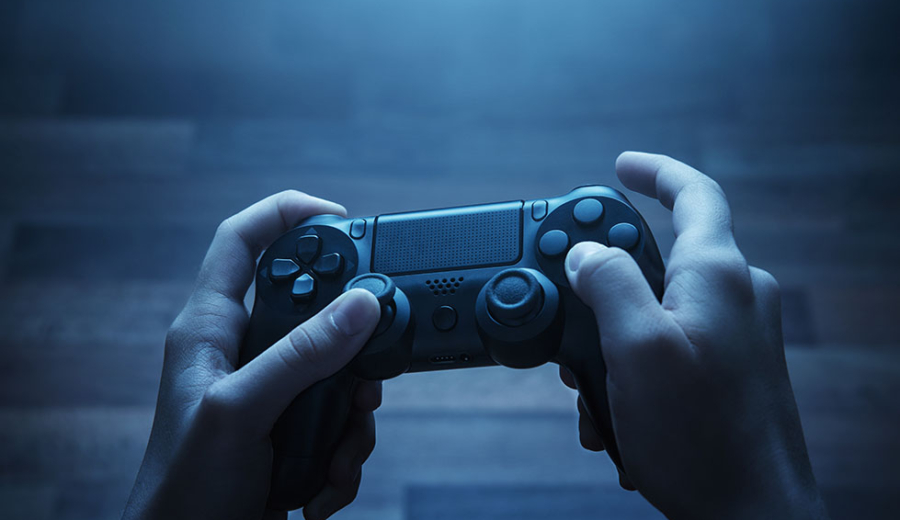 Man holding wireless gaming controller