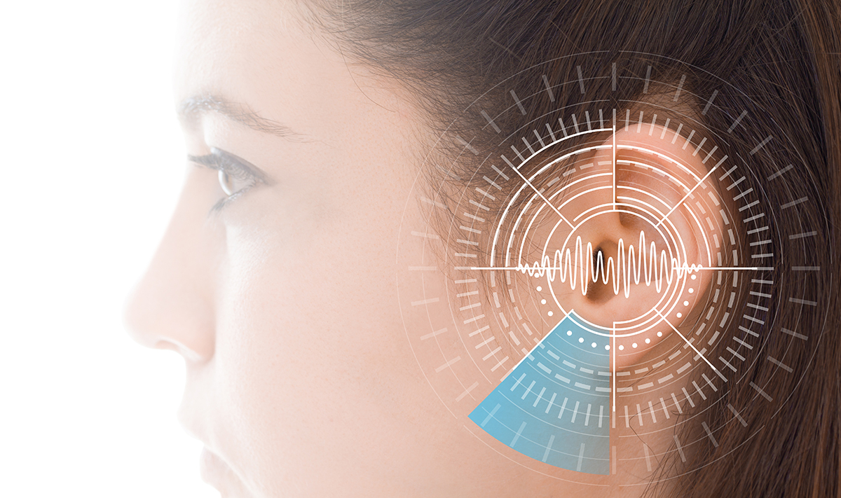 Hearing test showing ear of young woman